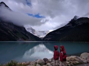 Hiking along the shores of glacial Lake Louise, Alberta, Canada