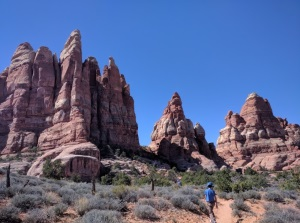 Hiking below the castle-like rocks of Joint Trail/Chestler Park, Utah, U.S.A.